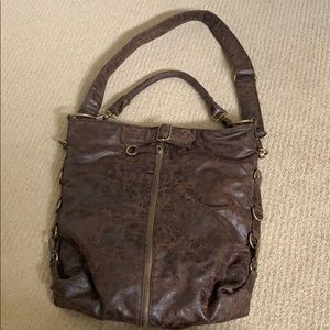 Rustic leather tote with adjustable crossbody.